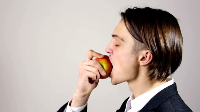 young man eating an apple video