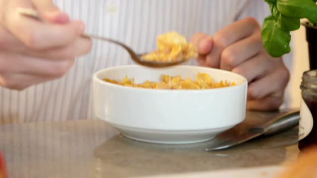 Young man eating cereals in the morning video