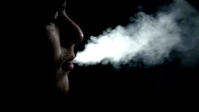 HD SLOW: Young man exhales the cigarette smoke video