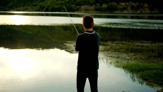 Young man fishing video