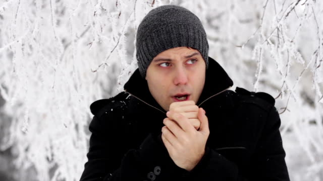 Young Man Freezing Outdoors Winter Cold Frostbite video