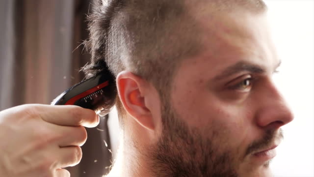 Awe Inspiring Young Man Getting His Hair Trimmed By Hair Cutting Machine In Slow Natural Hairstyles Runnerswayorg