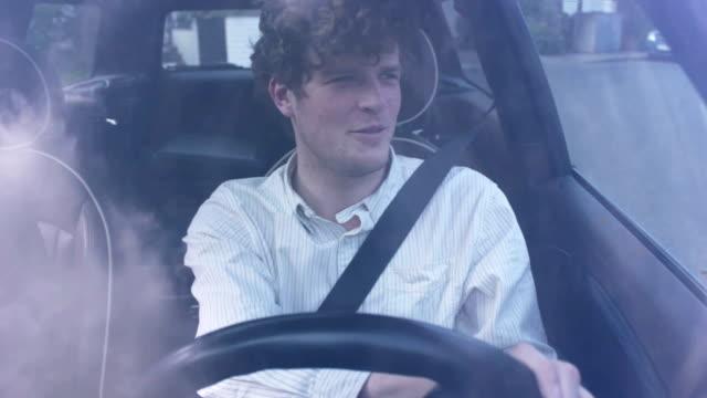 Young man having fun in his car video
