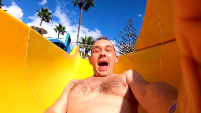 POV young man in a waterslide in water park in 4K Slow motion Professional video of POV young man in a waterslide in water park in 4K Slow motion 60fps outdoor play equipment stock videos & royalty-free footage