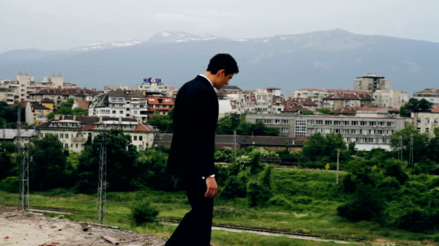 Young Man in Business Suite Attempting Suicide Europe Stress Concept video