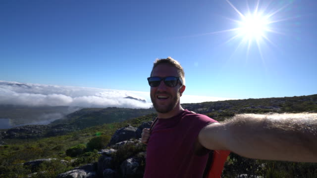 Young man in Cape Town taking selfie portrait Selfie time in South Africa. Young man takes selfie portrait in Cape Town table mountain national park stock videos & royalty-free footage