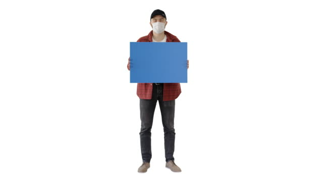 Young man in casual wear holding copy space board on white background