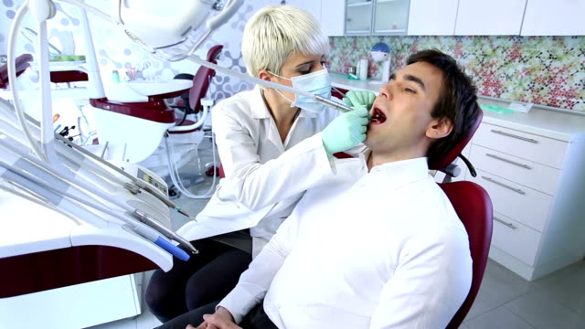 Young man in dentist office video