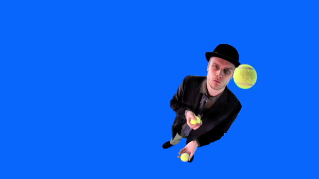 Young man in hat juggling balls video