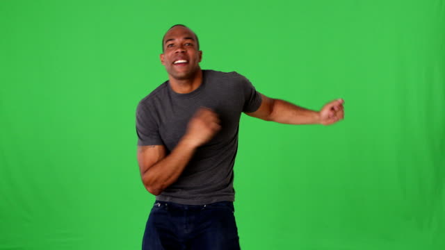 Young man in jeans and t-shirt  dancing video