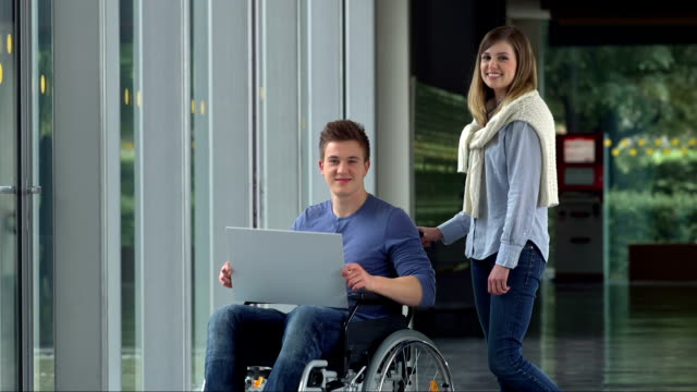 LS Young Man In Wheelchair Holding A Billboard video