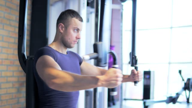 A young man is training in the gym. 4K video