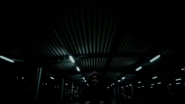 Young man jogs in a empty Parking Garage video