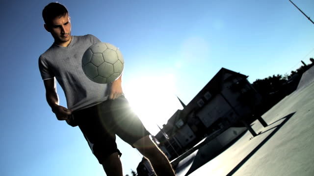 HD SUPER SLOW-MO: Young Man Juggling A Football video