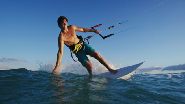 Young Man Kite Surfing in Slow Motion