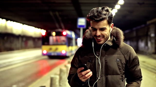 Young man listening music outdoors video