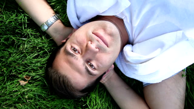 DOLLY: Young Man Lying On Grass - vídeo