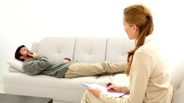 Psychiatrist And Patient On Couch