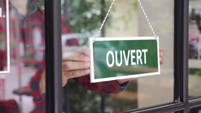 ung man öppna en fransk butik - fransk kultur bildbanksvideor och videomaterial från bakom kulisserna
