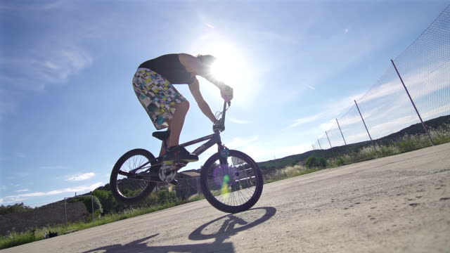 Young man performing a trick on a BMX bike video