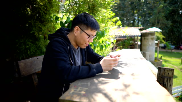 A Young Man Playing Games on the Phone video