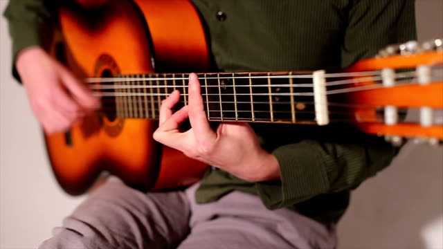 young man playing guitar - classical architecture stock videos & royalty-free footage