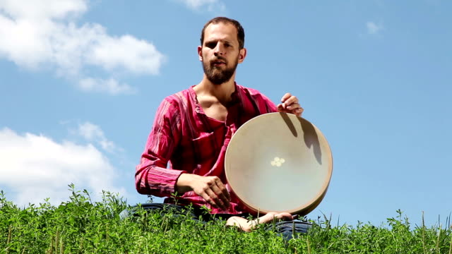 Young man playing the tambourine video