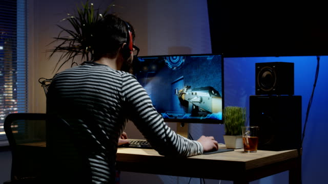 Young man playing video game inside a room
