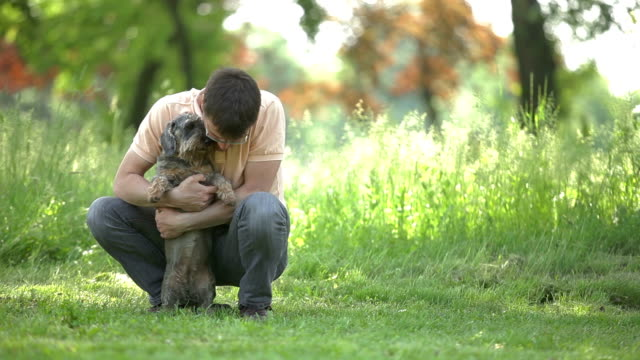 Young man playing with dog video