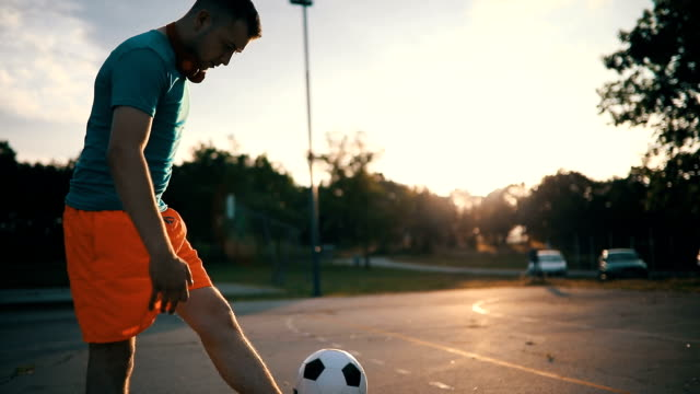 Young Man Playing With Soccer Ball video