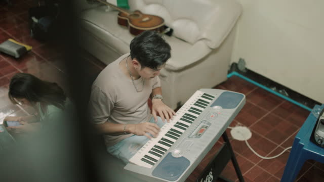 Young man Practicing Piano at home stock video