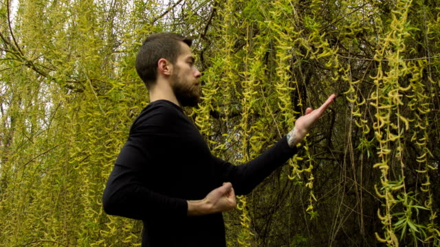 Young man practicing wing chun in the forest