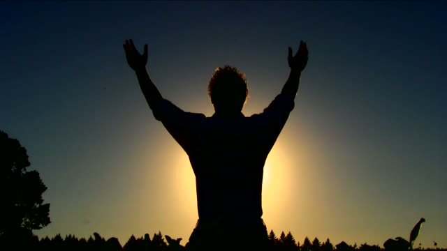 HD Young Man Praying Silhouetted video