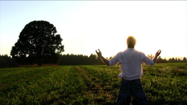 hd young man praying - god stock videos & royalty-free footage