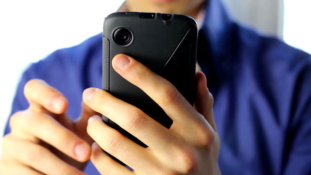 Young man receiving call, talking touch phone, close-up, focus video