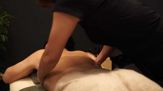 Young man receiving oil massage Back massage at the spa spa treatment stock videos & royalty-free footage