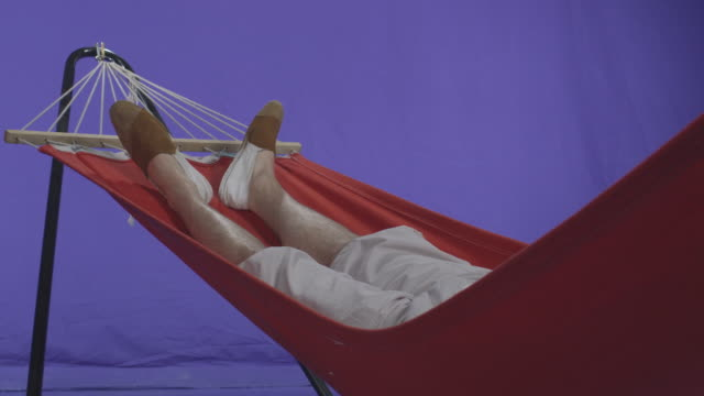 Young Man Relaxing In A Hammock Chroma Key video