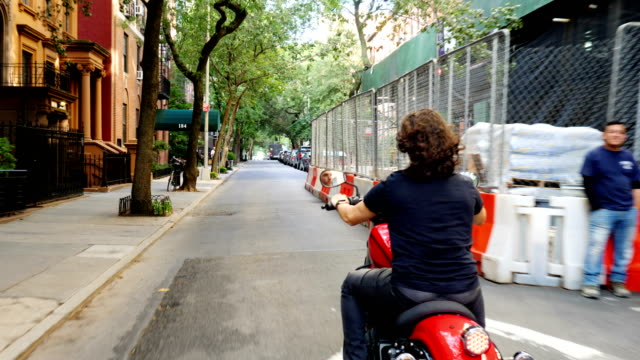 Young man riding a motorcycle in New York City video