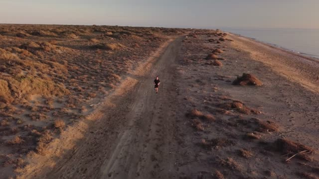 Young man running in the desert