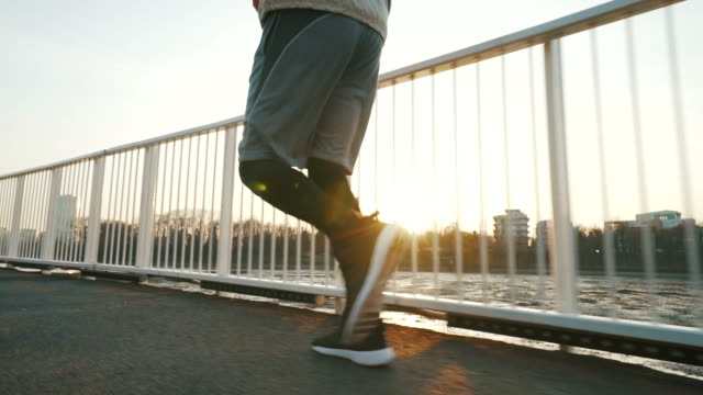 young man running. - parapetto barriera video stock e b–roll