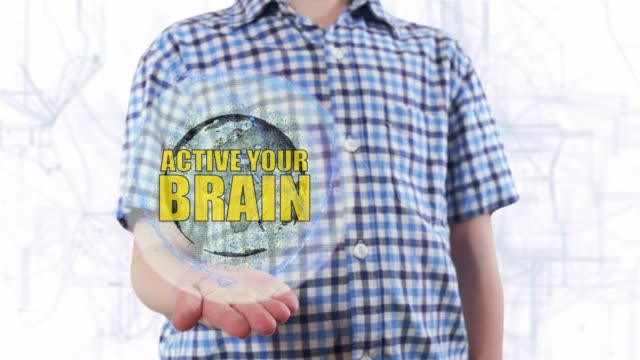 Young man shows a hologram of the planet Earth and text Active your brain