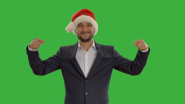 young man shows copy space  in a hat santa claus video