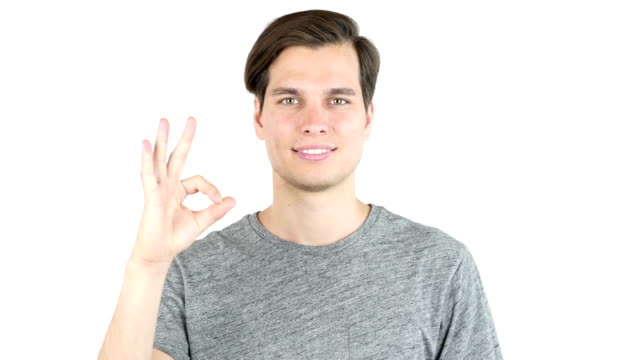 Young Man shows sign of Okay, All is well, Isolated on White Background video