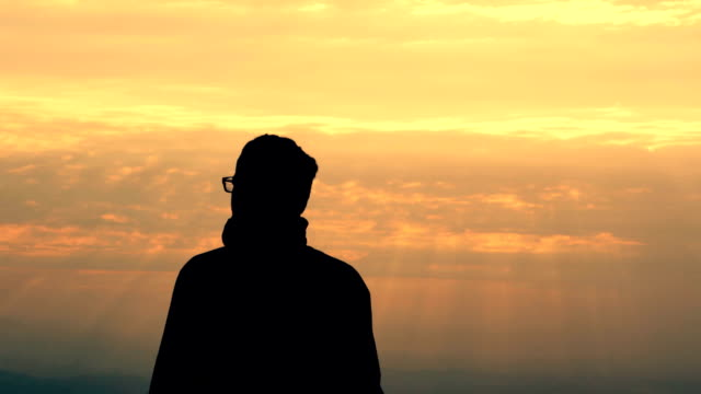 Young Man Silhouette On Mountain Top At Sunrise Video Hd