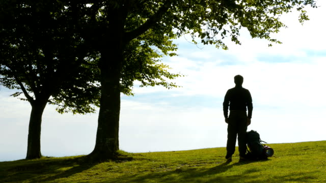 Young Man Silhouette With Backpack In Nature Video Hd Stock