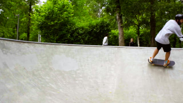 Young man skateboarding at outdoor skate park