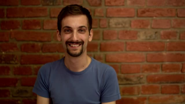 young man smiles while looking at the camera - miroslav mitic stock videos and b-roll footage