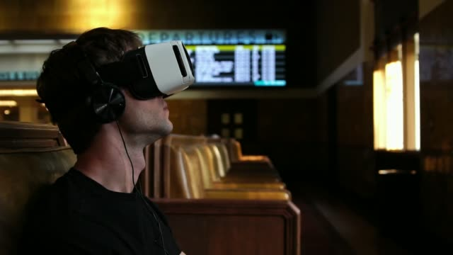 Young man spending time with VR-headset in Virtual Reality Glasses for travel video