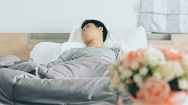 Young man take a rest on the bed with saline intravenous (iv) drip video