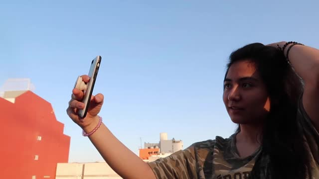 young man take selfie young man take selfie with phone in building sorpresa stock videos & royalty-free footage